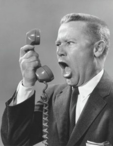 Complainer-Yelling-Phone-into-Man-Person-232x300