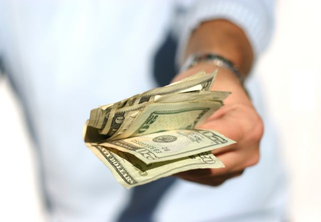 handing-over-money-sized
