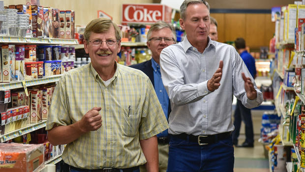 Governor Dennis Daugaard, right, takes a tour of A&M Market with owner Art Winsky while on tour of businesses in downtown Kimball on Wednesday. Kimball was selected as South Dakota's Capital for a Day by the Governor's office on Wednesday. (Matt Gade/Republic)